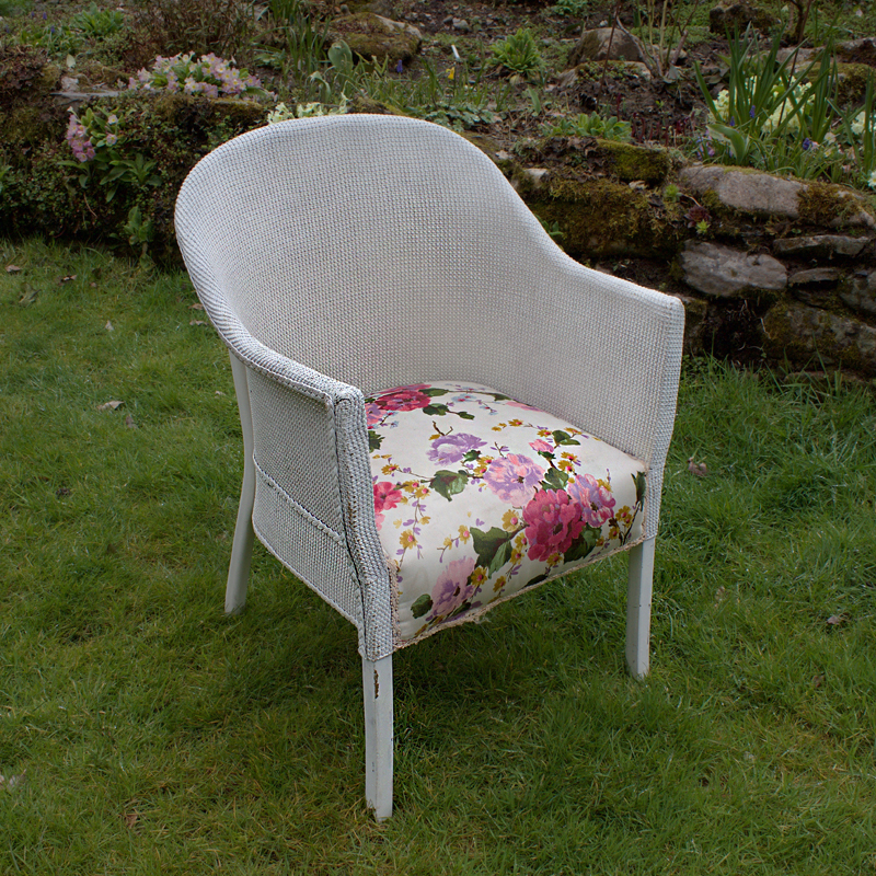 White Wicker Chair with Floral Seat