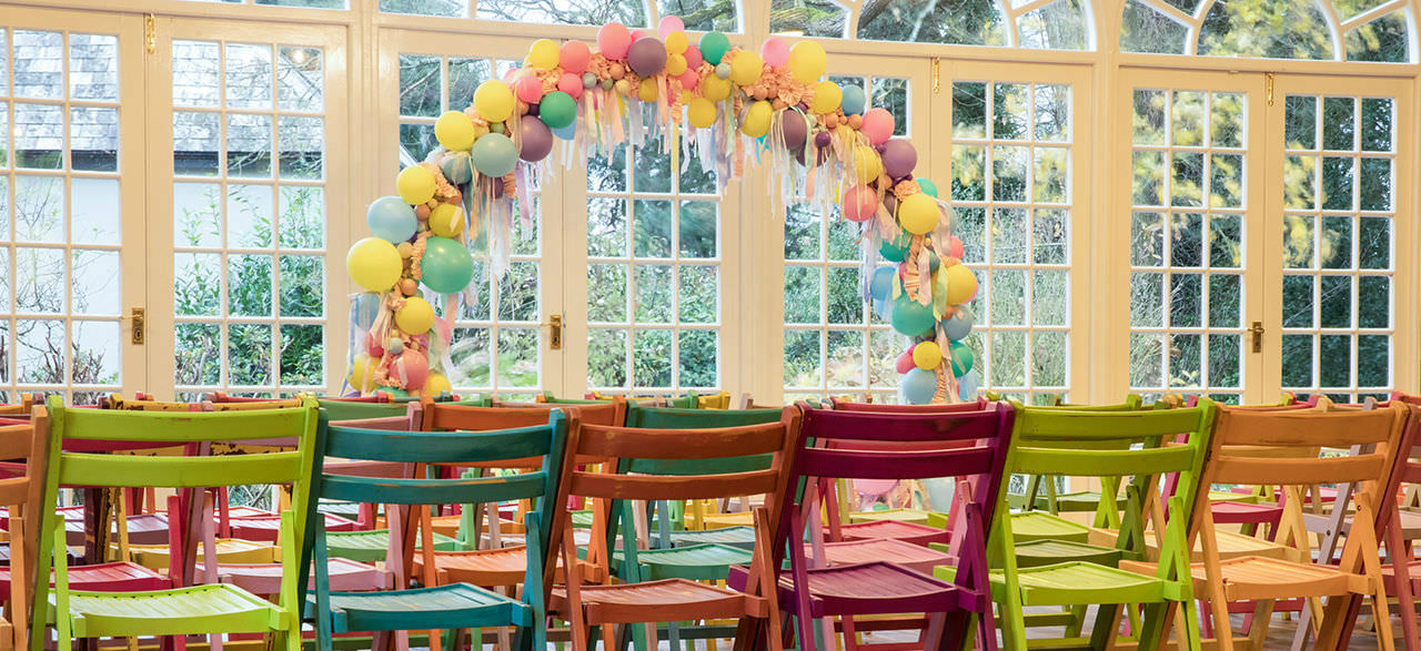 Balloon Arch and Chairs